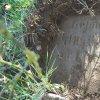 Semtěš - pískovcový kříž | horní část podstavce pískovcového kříže s vysekaným nápisem po odkrytí zeminy - duben 2016