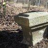 Kozlov - Schwarzmichlův kříž | částečně zahrnutý žulový podstavec Schwarzmichlova kříže u hřbitova v Kozlově - březen 2017