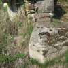 Kozlov - sousoší Nejsvětější Trojice | zachovalý trojboký sokl podstavce sousoší Nejsvětější Trojice - duben 2013