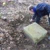 Žlutice - Spinkův kříž | odkrývání pozůstatků podstavce kříže - duben 2012