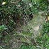 Skoky - železný kříž   povalený podstavec bývalého kříže při kamenné zídce u cesty na jižním okraji vsi Skoky - září 2015