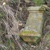 Skoky - železný kříž   povalený podstavec bývalého kříže při kamenné zídce u cesty na jižním okraji vsi Skoky - březen 2016