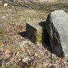 Služetín - pomník obětem 1. světové války | přední strana kamenné stély s dnes již zcela setřelými jmény veteránů ze Služetína - březen 2018