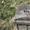 Dlouhá Ves - železný kříž | torzo ulomeného vrcholového litinového kříže v horní ploše žulového podstavce - březen 2017